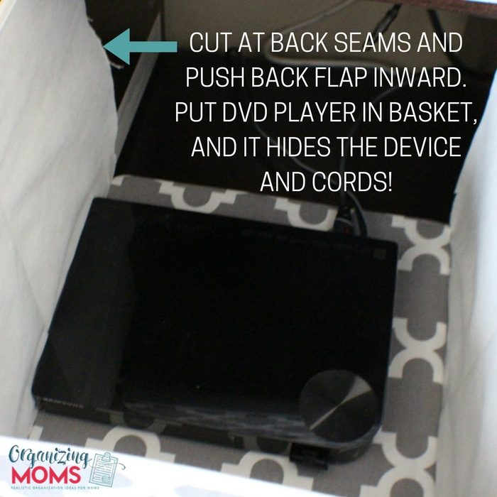 Cut back seams of a storage cube to house DVD player.