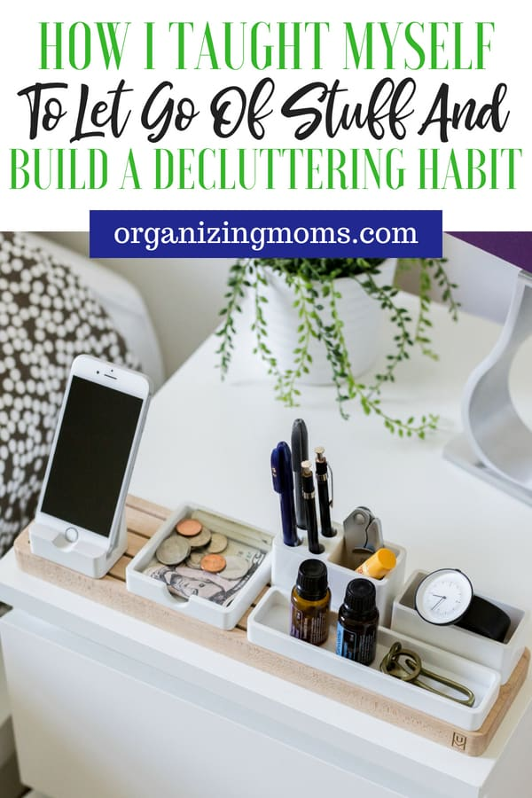 Text - How I Taught Myself to Let Go of Stuff and Build a Decluttering Habit organizingmoms.com Image of phone, pens, money, watch, organized in containers on a bedside table.