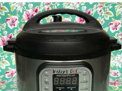 Text - Instant Pot Tips and Tricks. Image of Instant Pot on floral background.