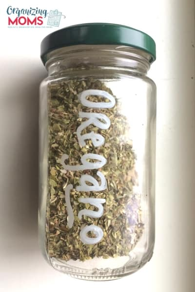 A close up of an oregano spice bottle