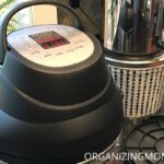 Side angle view of Instant Pot air fryer lid on kitchen counter.