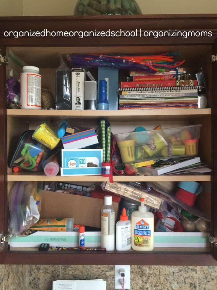 Messy cabinet before organizing children's art supplies.