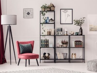 organized black shelf with red chair and lamp