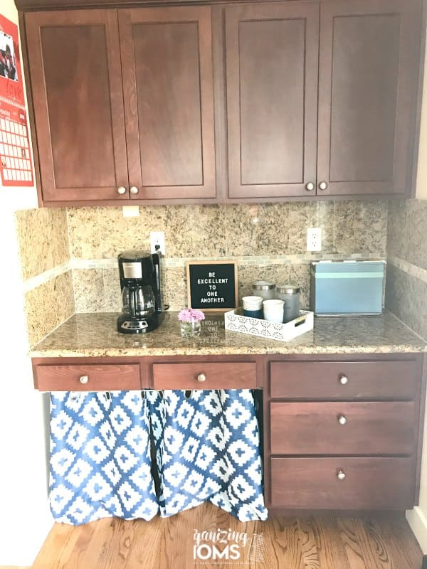 We repurposed our kitchen desk as a coffee and wine bar. Now we have so much more storage space in our kitchen!