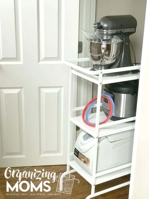 An under the stairs closet storage solution that is versatile and large enough to hold small kitchen appliances.