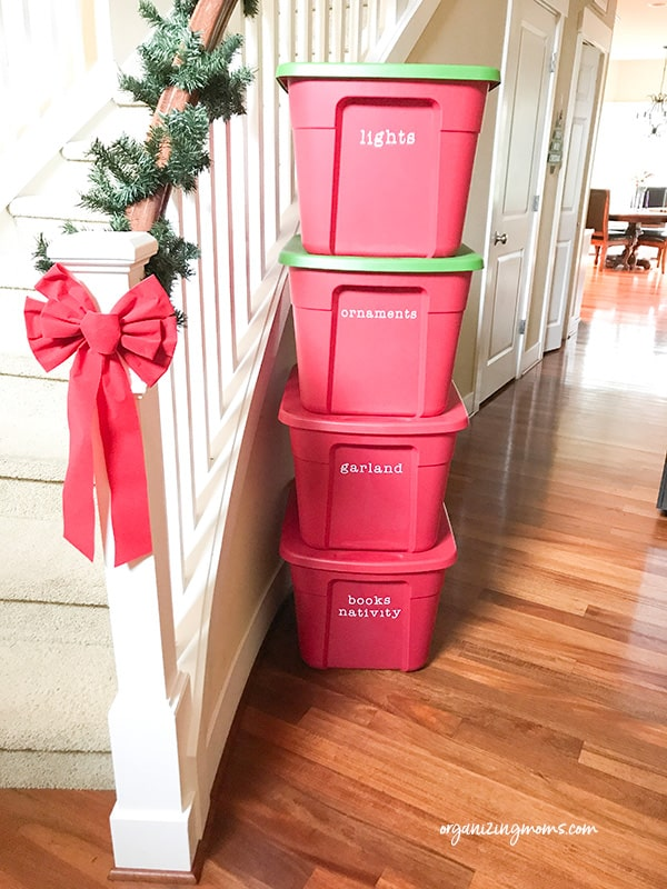 christmas storage tubs by stairs