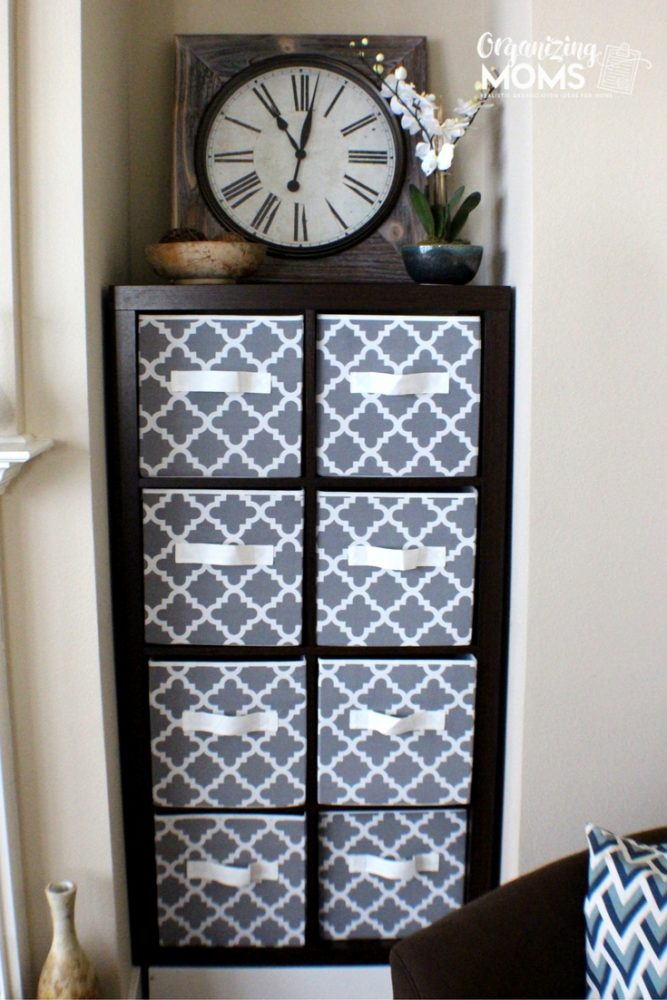 How to use a cube shelf storage system to organize a family room.