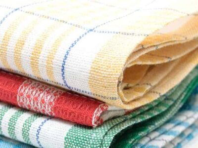 Clear space in your kitchen by decluttering and organizing your kitchen towels. Linens take up a lot of space - keep the best of the best and get rid of the rest.