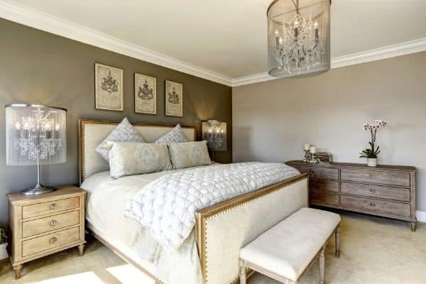 decluttered bedroom with gray walls white bed dressers