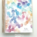 Personalized Erin Condren Deluxe Monthly Planner cover with rose gold spiral.