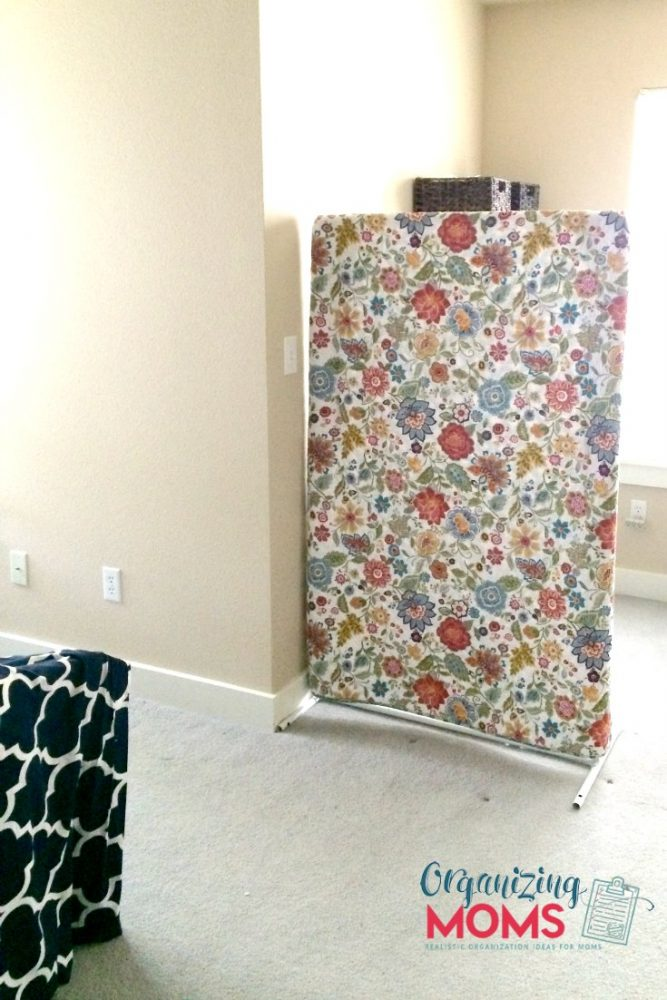 DIY room divider on a budget separates office space from bedroom.