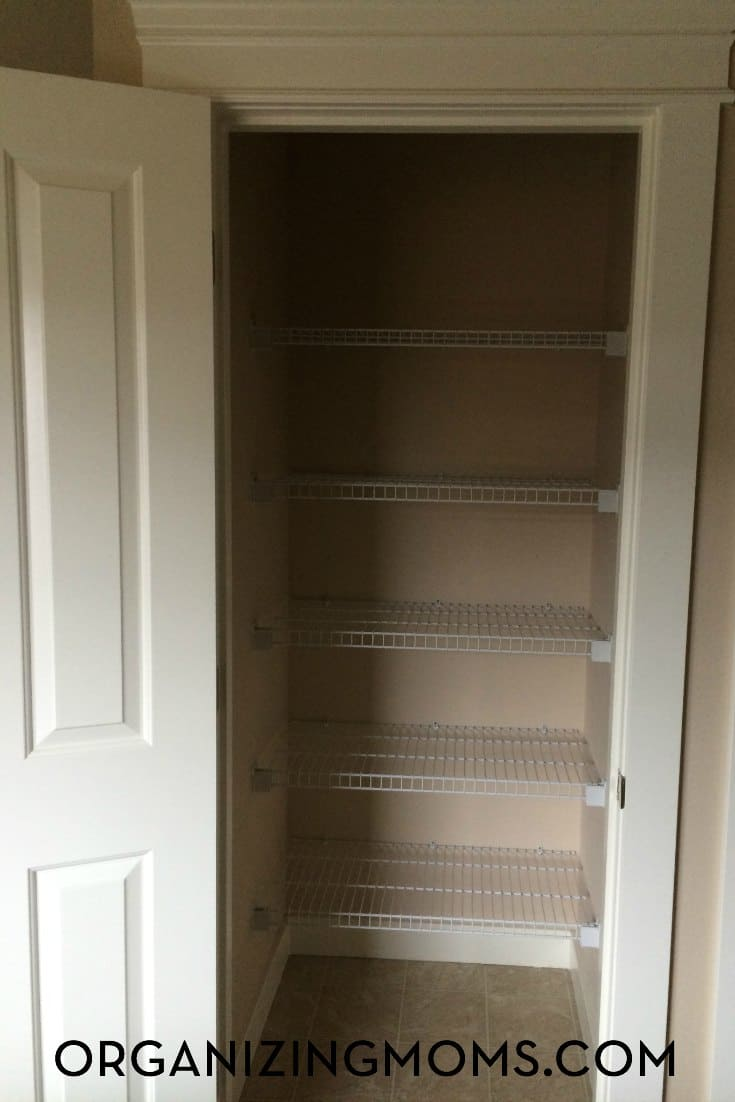 Part of the linen closet organization project involved decluttering and clearing out the closet.