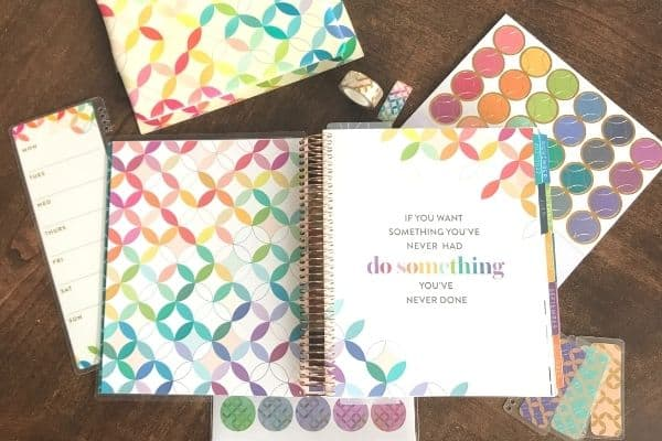 erin condren life planner opened with stickers and tape surrounding