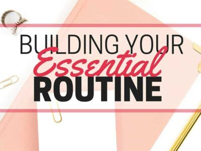 Text - Building Your Essential Routine - Background image of pink and gold office supplies.