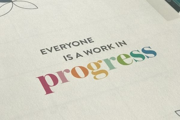 everyone is a work in progress erin condren life planner quote page