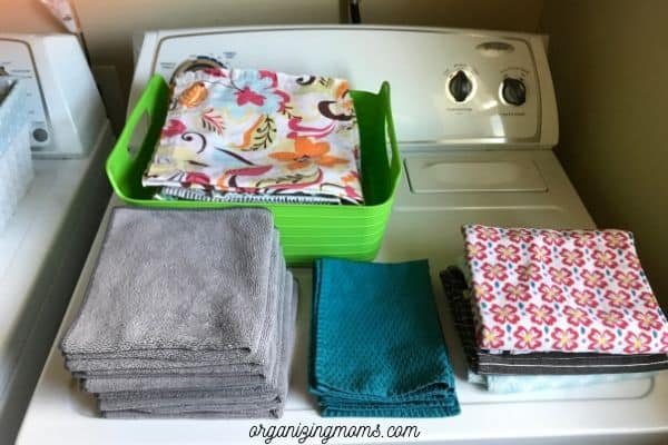 folded linens in laundry room