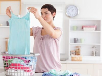 folding clothes in organized laundry room