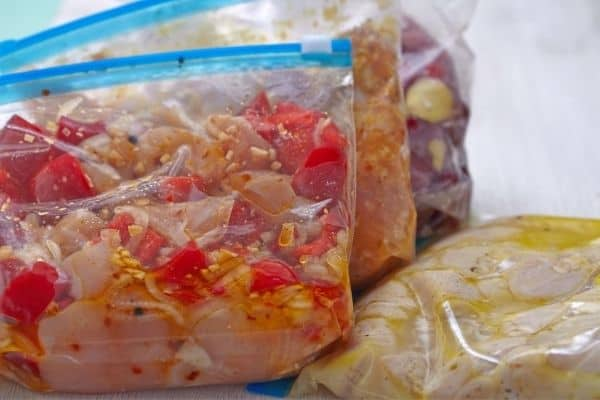 A close up of frozen food freezer meals in plastic bags