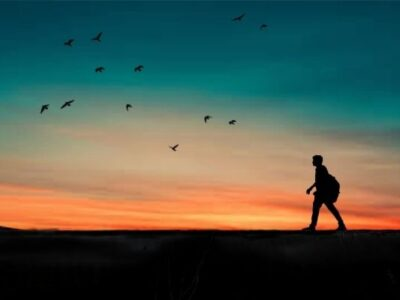 person walking in front of sunset to illustrate get more steps each day