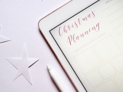 christmas planning page on ipad with stylus to symbolize getting ready for christmas in october