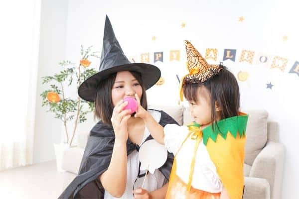 mom and preschooler dressed as witches to symbolize halloween party ideas for preschoolers