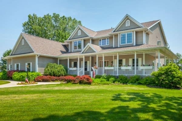 beautiful brown home with green lawn to symbolize putting home maintenance on autopilot