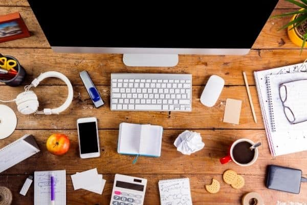 office supplies on desk to effectively plan your week