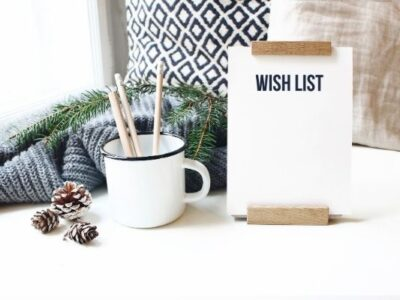 wish list in front of cozy blanket, pillow, mug