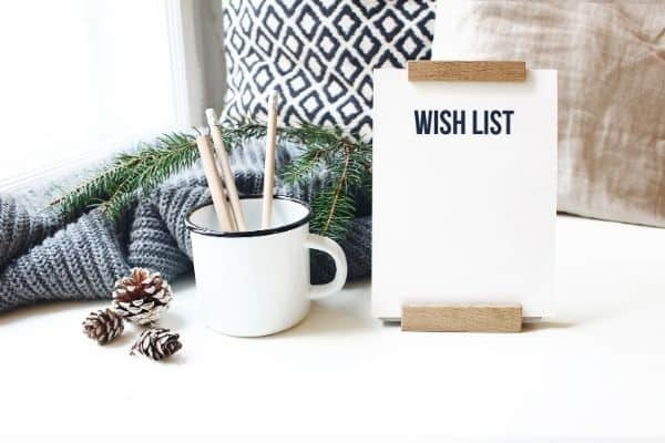 wish list in front of cozy blanket, pillow, mug