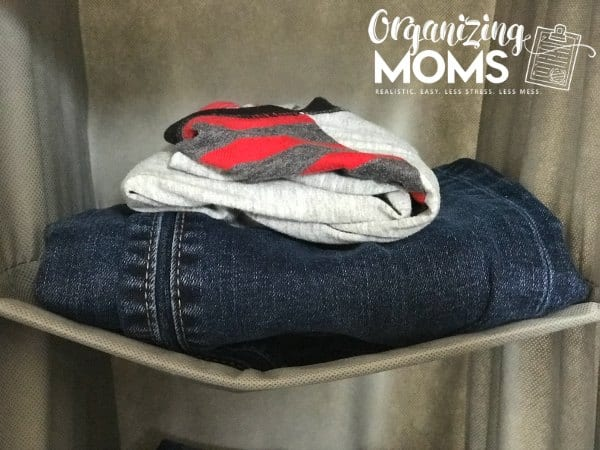 One shirt and one pair of jeans in each cubby. How to help your child organize clothes.