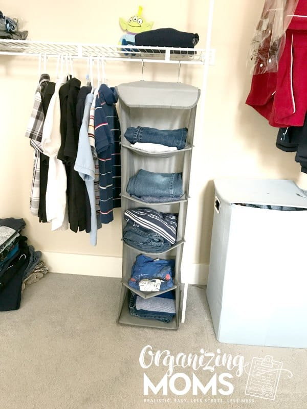 Inside organized child closet. How to help your child organize clothes.
