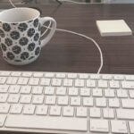 keyboard and coffee mug on desk