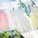 girls dresses drying on clothesline to symbolize laundry routine