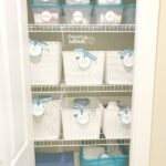 Use baskets and storage bins to organize your linen closet and eliminate visual clutter.
