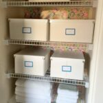 Linen closet organization with versatile boxes. A great way to contain linens and toiletries!