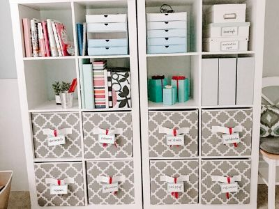 Cube shelf organizer filled with books, boxes, and organizational bins.