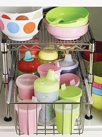 Sippy cups organized in metal drawer organize in bottom cabinet.