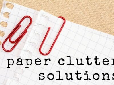 text paper clutter solutions graph paper with red paperclips