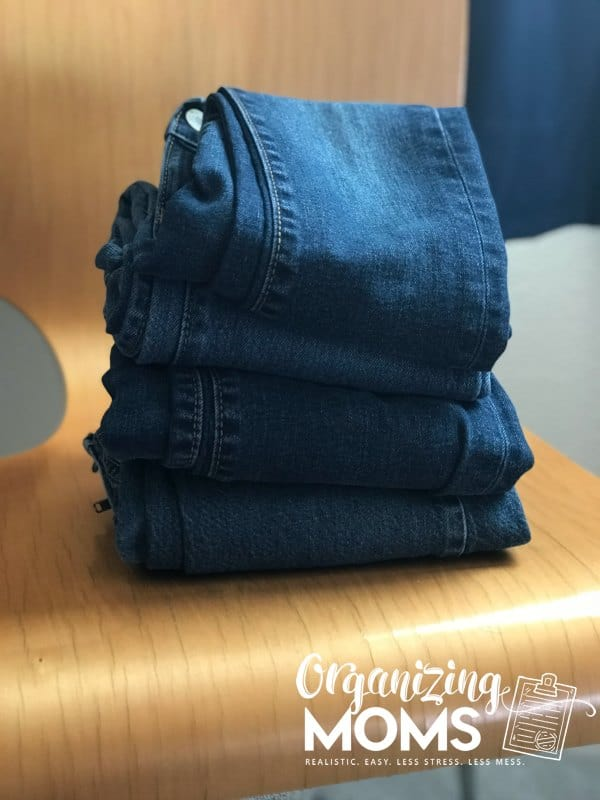 Teach your kids to put clothes away one item type at a time. How to help your child organize clothes.