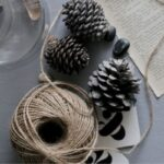 items to declutter before holidays - pinecones page of book pinecones string