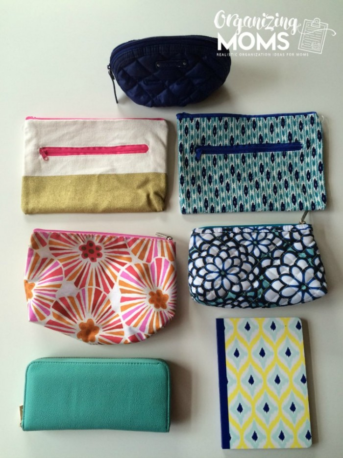 A group of pouches for a purse on a table