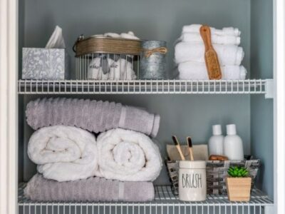 organized linen closet with gray white towels