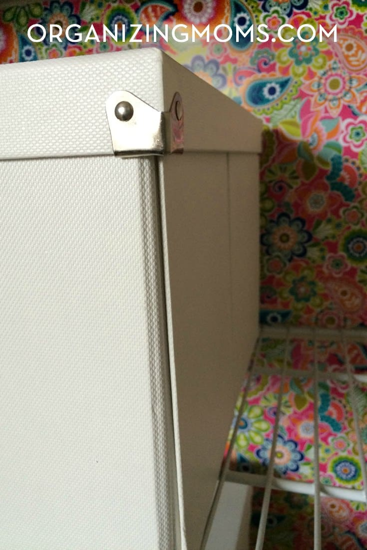 Sturdy, versatile boxes help keep this linen closet organized.