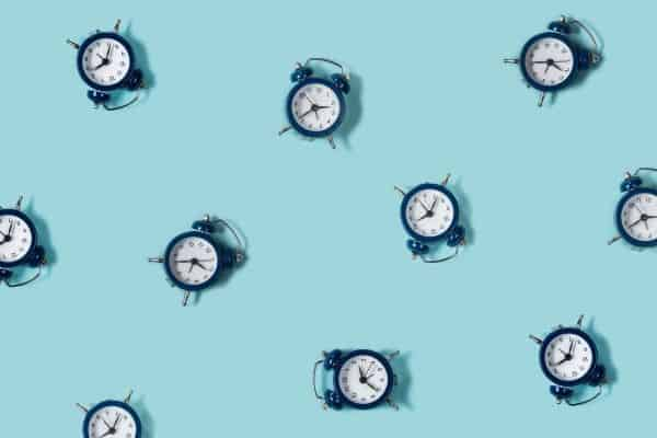 blue clocks on aqua background to symbolize shorter timeframe