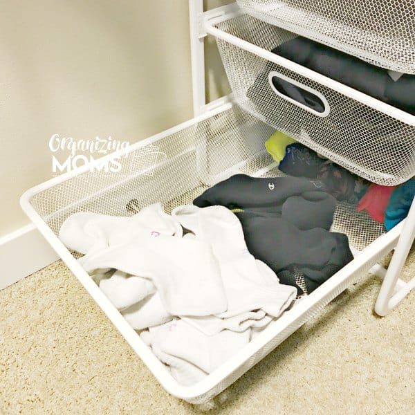 Sock basket drawer in closet for easy sock storage.