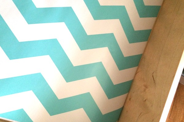 Close up of blue and white chevron striped spice drawer liner