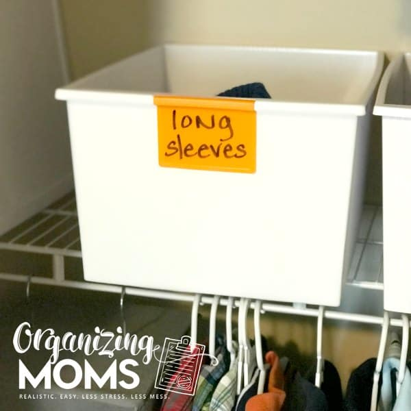 Store extra clothes for kids in extra bins with dry erase labels.