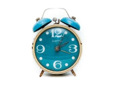 A close up of a turquoise clock used for time management
