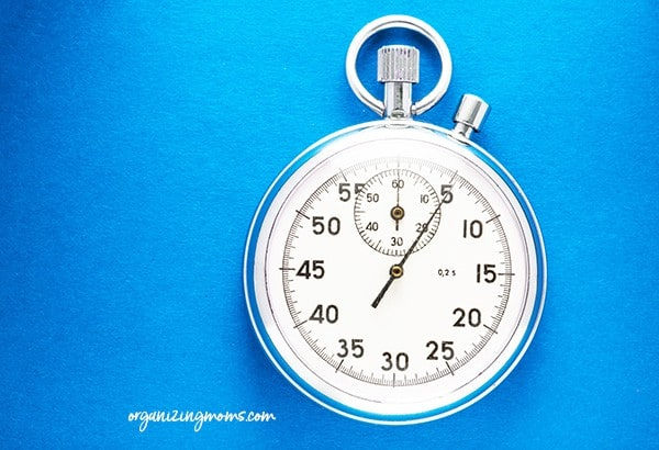 A stopwatch used as a timer on white background.