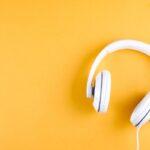 white headphones on yellow background